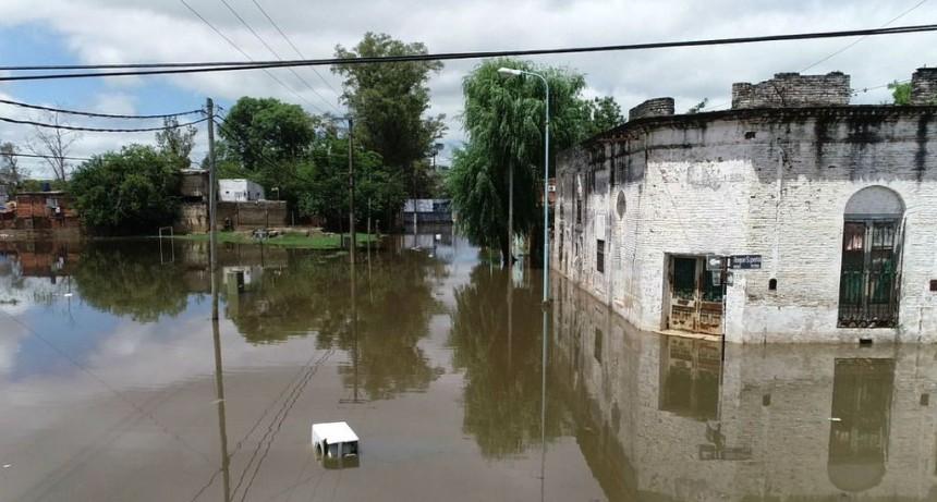 El arraigo de los inundados, la otra cara de la creciente del río Uruguay
